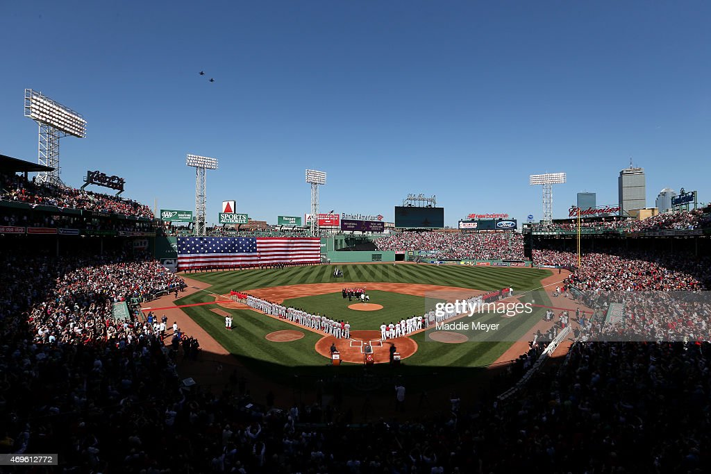 The Boston Red Sox and the Washington Nationals stand on the field for the National Anthem before the game at Fenway Park on April 13, 2015 in Boston, Massachusetts.