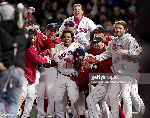The Boston Red Sox are elated as they wait at the plate for David Ortiz to score after he hit a game-winning, two-run homer in the 12th inning of the...