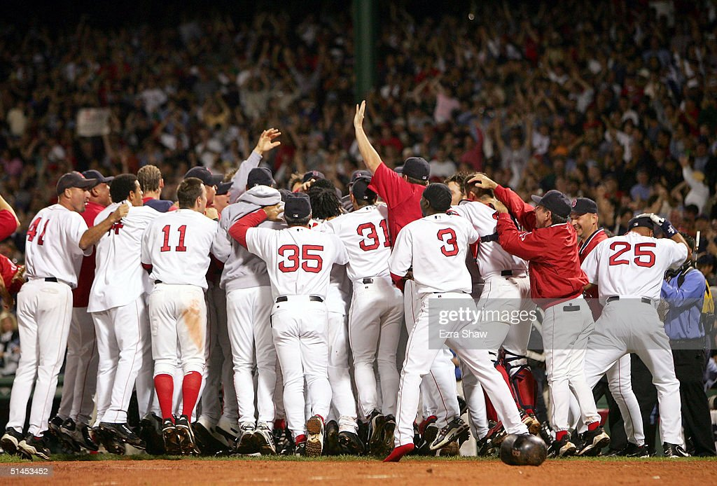 The Boston Red Sox celebrate after David Ortiz #34 hit the game-winning home run to defeat the Anaheim Angels 8-6 in the 10th inning of Game 3 of the American League Division Series October 8, 2004 at Fenway Park in Boston, Massachusetts. The Red Sox sweep the best-of-five series.