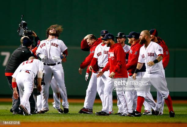 The Boston Red Sox celebrate after defeating the Detroit Tigers 65 in Game Two of the American League Championship Series at Fenway Park on October...