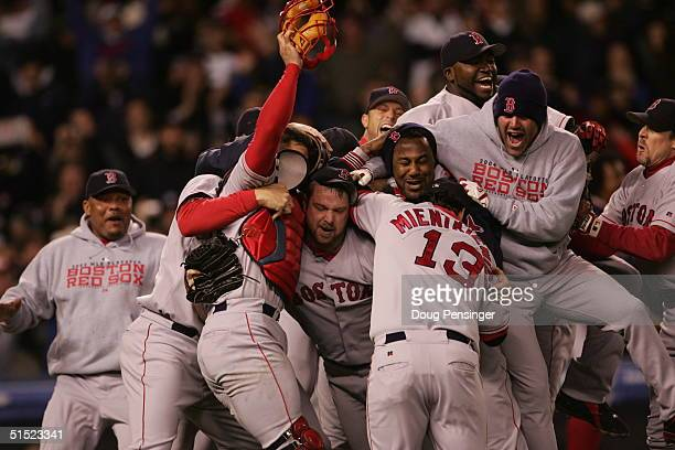 The Boston Red Sox celebrate after defeating the New York Yankees 10-3 in game seven of the American League Championship Series on October 20, 2004...