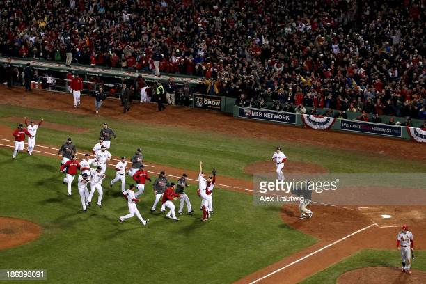 The Boston Red Sox celebrate after defeating the St Louis Cardinals in Game Six of the 2013 World Series at Fenway Park on October 30 2013 in Boston...