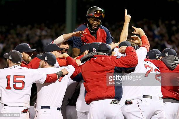 The Boston Red Sox celebrate after defeating the St. Louis Cardinals in Game Six of the 2013 World Series at Fenway Park on October 30, 2013 in...