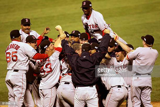 The Boston Red Sox celebrate after defeating the St. Louis Cardinals 3-0 to win game four of the World Series on October 27, 2004 at Busch Stadium in...