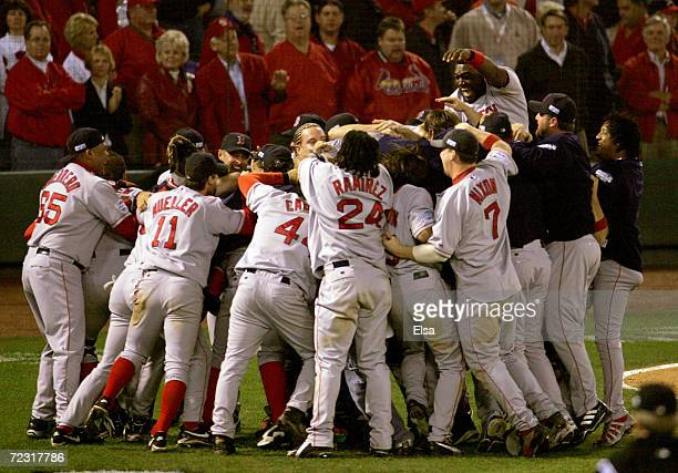 The Boston Red Sox celebrate after defeating the St Louis Cardinals 30 to win game four of the World Series on October 27 2004 at Busch Stadium in St...