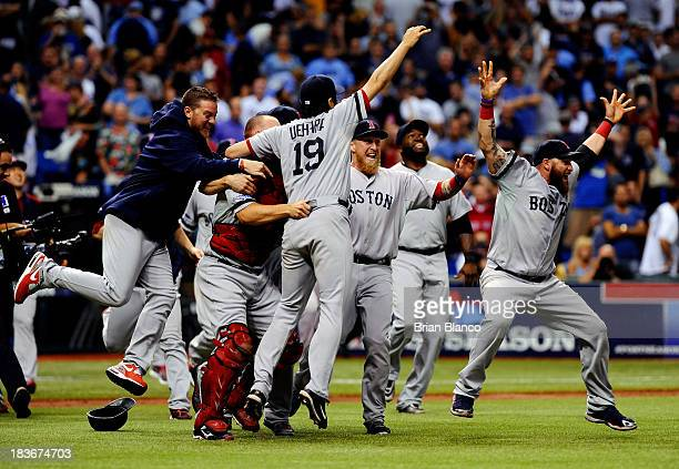 The Boston Red Sox celebrate after defeating the Tampa Bay Rays 31 in Game Four of the American League Division Series at Tropicana Field on October...