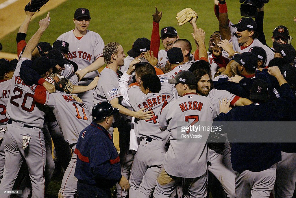 The Boston Red Sox celebrate after winning game four of the 2004 World Series against the St. Louis Cardinals at Busch Stadium on October 27, 2004 in St. Louis, Missouri. The Red Sox defeated the Cardinals 3-0 to win their first World Series in 86 years.