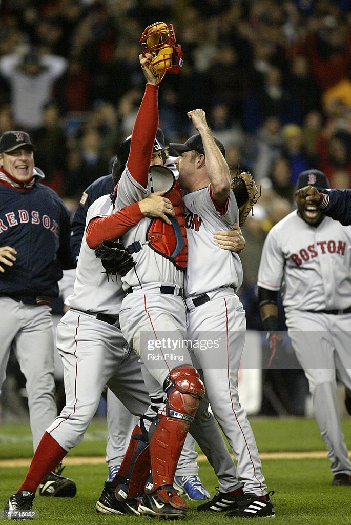 The Boston Red Sox celebrate after winning game seven of the ALCS against the New York Yankees at Yankee Stadium on October 20, 2004 in the Bronx, New York. The Red Sox defeated the Yankees 10-3 to win the series four games to three.
