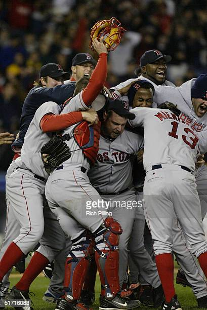The Boston Red Sox celebrate after winning game seven of the ALCS against the New York Yankees at Yankee Stadium on October 20 2004 in the Bronx New...