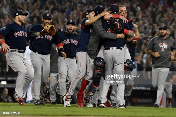The Boston Red Sox celebrate around Chris Sale after their 51 win over the Los Angeles Dodgers in Game Five to win the 2018 World Series at Dodger...