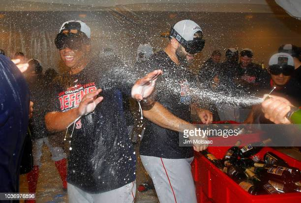 The Boston Red Sox celebrate in the locker room after defeating the New York Yankees to clinch the American League East Division at Yankee Stadium on...