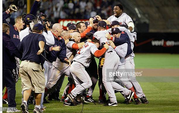 The Boston Red Sox celebrate the victory over the Oakland A's in game 5 of the 2003 American League Divisional Series at the Network Associates...
