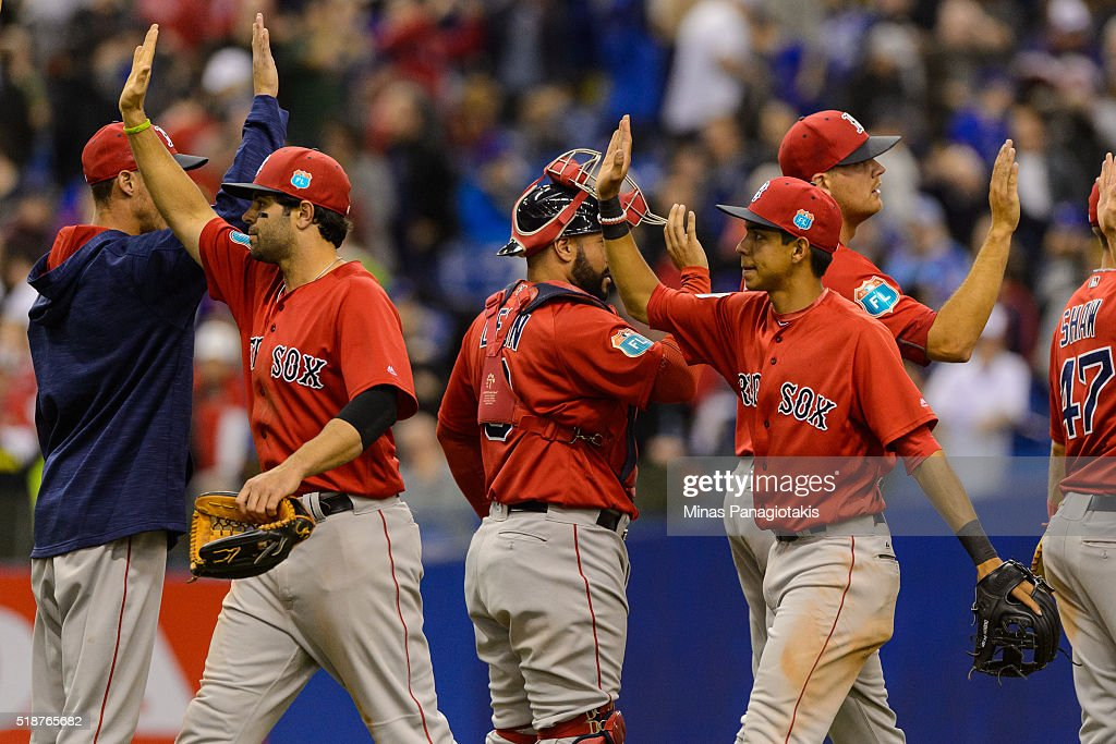 The Boston Red Sox celebrate their victory over the Toronto Blue Jays during the MLB spring training game at Olympic Stadium on April 2, 2016 in Montreal, Quebec, Canada. The Boston Red Sox defeated the Toronto Blue Jays 7-4.