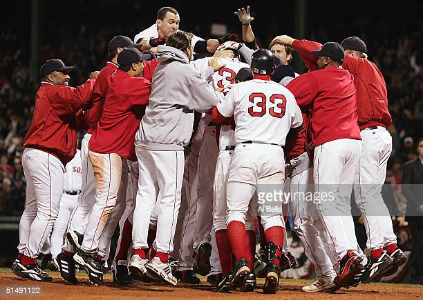 The Boston Red Sox celebrate with teammate David Ortiz after he hit a tworun game winning home run against the New York Yankees in the twelfth inning...