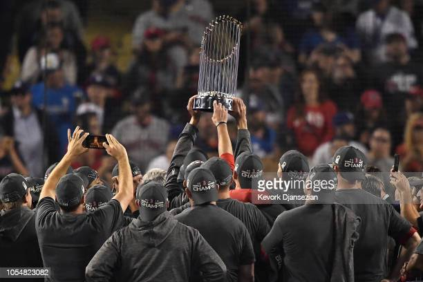 The Boston Red Sox celebrate with the World Series trophy after their 51 win over the Los Angeles Dodgers in Game Five to win the 2018 World Series...