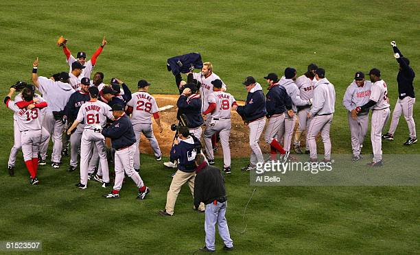 The Boston Red Sox celebrates after defeating the New York Yankees 103 to win game seven of the American League Championship Series on October 20...
