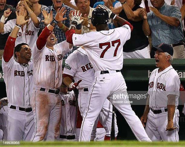 The Boston Red Sox dugout celebrates a solo home run by Boston Red Sox second baseman Pedro Ciriaco which was a bright spot in an otherwise deflating...