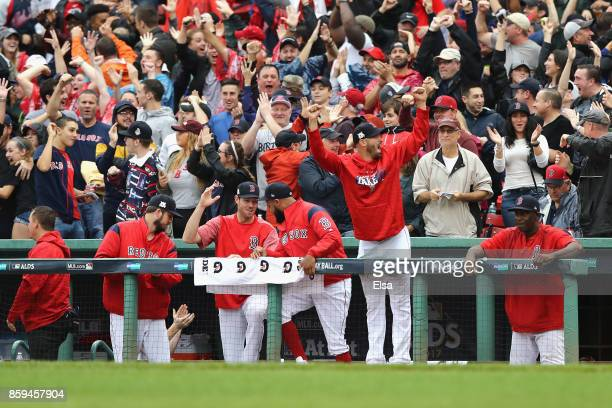The Boston Red Sox dugout reacts after Andrew Benintendi of the Boston Red Sox hit a tworun home run in the fifth inning against the Houston Astros...