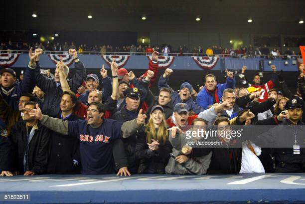 The Boston Red Sox fans celebrate after defeating the New York Yankees 103 to win game seven of the American League Championship Series on October 20...