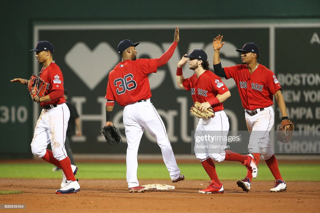 The Boston Red Sox high five each other after the victory over the New York Yankees at Fenway Park on August 18, 2017 in Boston, Massachusetts.