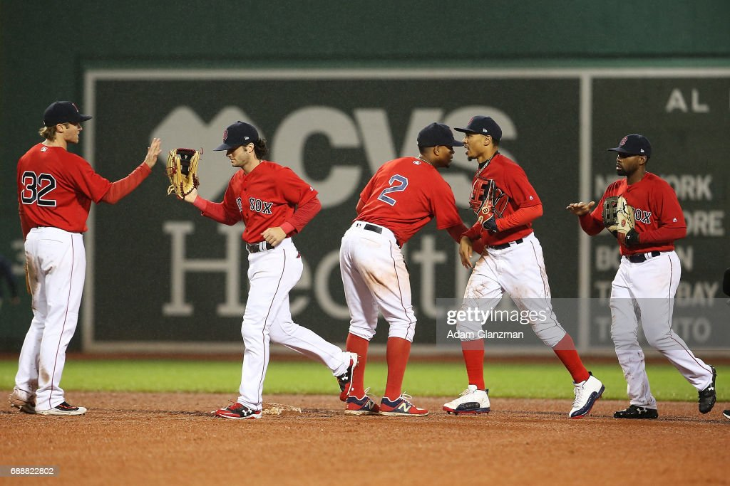The Boston Red Sox high five eachother after their victory over the Seattle Mariners at Fenway Park on May 26, 2017 in Boston, Massachusetts.