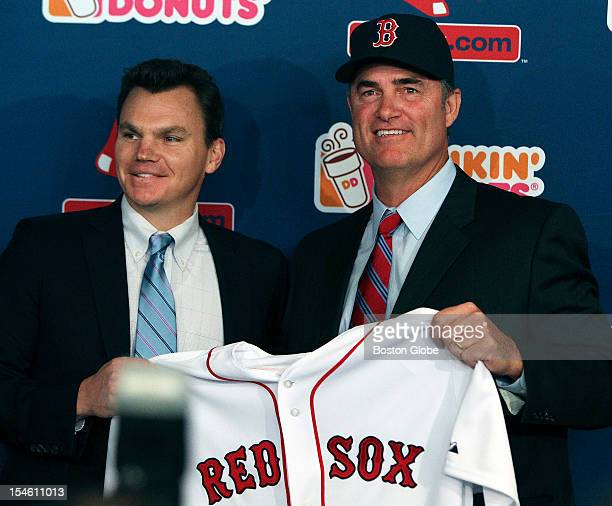 The Boston Red Sox introduced new manager John Farrell right at a noon press conference at Fenway Park Here he poses with general manager Ben...