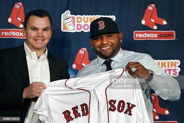 The Boston Red Sox introduced newly signed third baseman Pablo Sandoval right at a press conference at Fenway Park Sandoval holding up his new jersey...