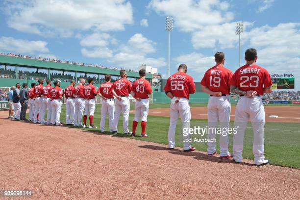 The Boston Red Sox line up during the playing of the National Anthem prior to the spring training game against the Chicago Cubs at JetBlue Park on...