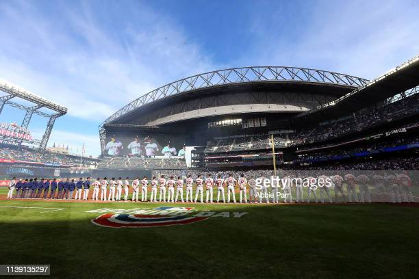 The Boston Red Sox lineup for the National Anthem prior to taking on the Seattle Mariners during their Opening Day game at T-Mobile Park on March 28,...