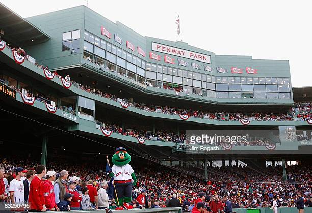 The Boston Red Sox mascot Wally the Green Monster stands on the dugout inbetween innings of game three of the American League Championship Series...