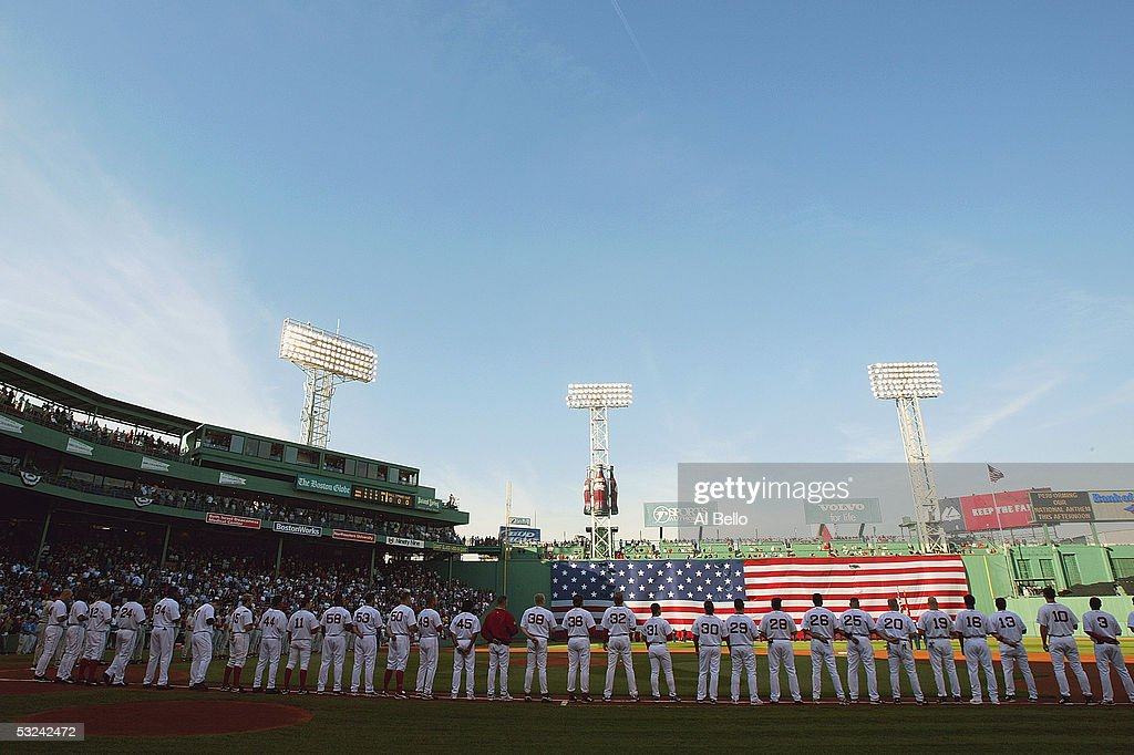The Boston Red Sox observe the national anthem before the American League Division Series with the Anaheim Angels, Game 3 on October 8, 2004 at Fenway Park in Boston, Massachusetts.