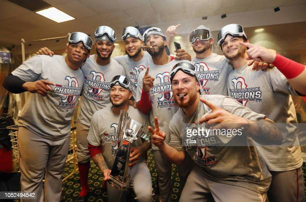 The Boston Red Sox pose with the William Harridge Trophy in the clubhouse after defeating the Houston Astros 41 in Game Five of the American League...