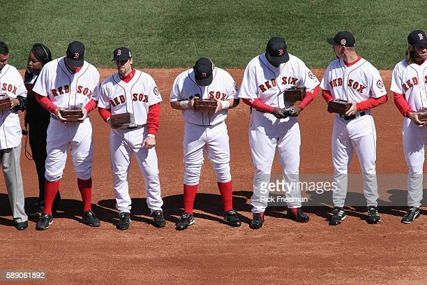 The Boston Red Sox receive their world series rings during a pregame ceremony at Fenway Park in Boston as the Boston Red Sox play the New York...