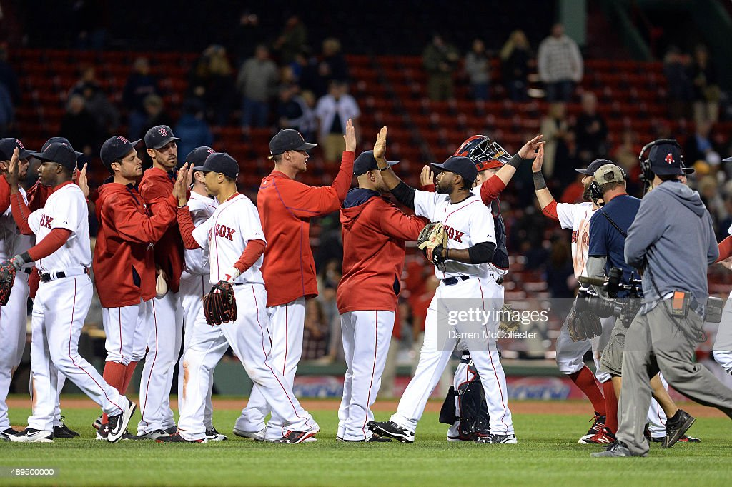 The Boston Red Sox slap high fives after the game against the Tampa Bay Rays at Fenway Park on September 21, 2015 in Boston, Massachusetts. The Red Sox won the game 8-7.