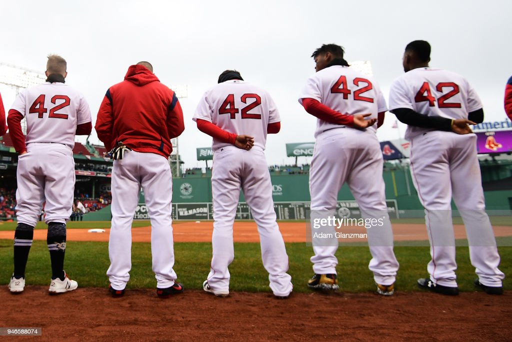 The Boston Red Sox stand for the national anthem before a game against the Baltimore Orioles at Fenway Park on April 15, 2018 in Boston, Massachusetts. All players are wearing #42 in honor of Jackie Robinson Day.