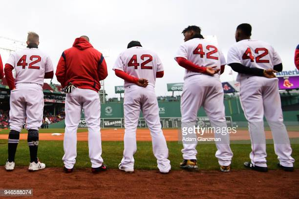 The Boston Red Sox stand for the national anthem before a game against the Baltimore Orioles at Fenway Park on April 15 2018 in Boston Massachusetts...