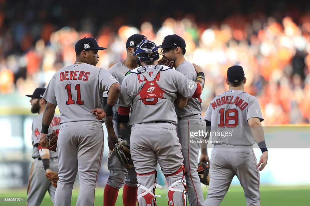 The Boston Red Sox talk to Joe Kelly #56 of after loading the bases in the sixth inning against the Houston Astros during game one of the American League Division Series at Minute Maid Park on October 5, 2017 in Houston, Texas.