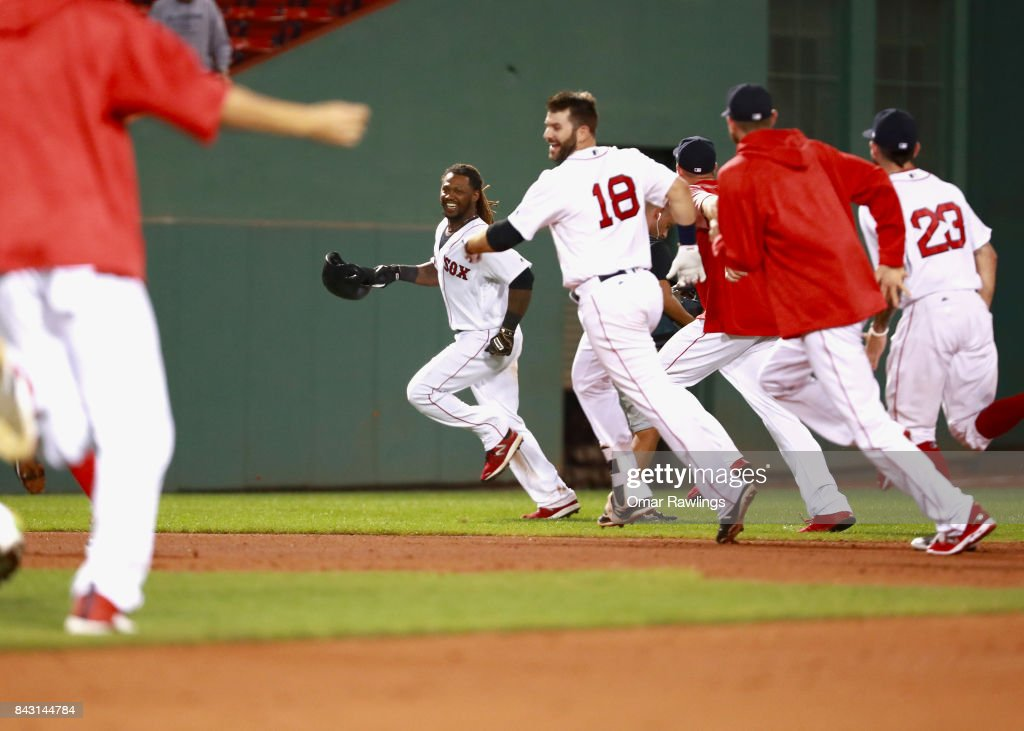 The Boston Red Sox team chases Hanley Ramirez #13 of the Boston Red Sox after he hits an RBI single in the bottom of the nineteenth inning to win the game against the Toronto Blue Jays at Fenway Park on September 5, 2017 in Boston, Massachusetts.
