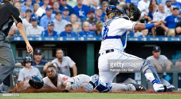 The Boston Red Sox's Jackie Bradley Jr. Scores before the tag from Kansas City Royals catcher Salvador Perez on a double by Sam Travis in the fourth...
