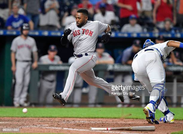 The Boston Red Sox's Jackie Bradley Jr scores past the throw to Kansas City Royals catcher Salvador Perez on a triple by Mookie Betts in the ninth...