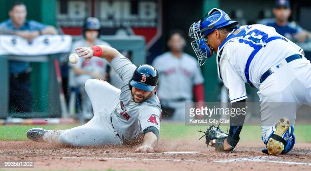 The Boston Red Sox's Mitch Moreland left scores as Kansas City Royals catcher Salvador Perez loses the ball on a threerun double by Boston's Xander...