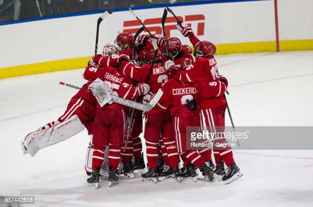 The Boston University Terriers celebrate a 31 victory against the Cornell Big Red during the NCAA Division I Men's Ice Hockey Northeast Regional...