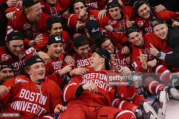 The Boston University Terriers celebrate their win over the Northeastern Huskies 4-3 during overtime in 2015 Beanpot Tournament Championship game at...