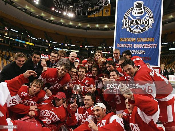 The Boston University Terriers pose with the Beanpot trophy after their overtime win over the Boston College Eagles after the Beanpot Tournament...