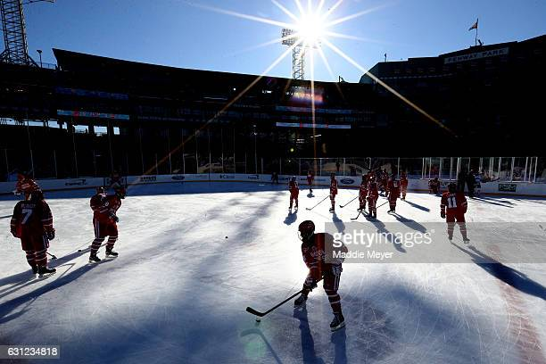 The Boston University Terriers warm up before their game against the Massachusetts Minutemen at Fenway Park on January 8, 2017 in Boston,...