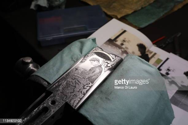 The bottom of a rifle with an image of the Perazzi founder Daniele produced at the request of a client by Giuseppe Zacchi Perazzi's master engraver...