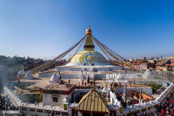The Bouda Stupa is the centre of buddhist spirituality in town, the white building is decorated by colorful tibetean prayerflags.
