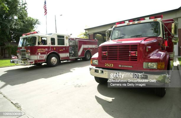 The Boulder Fire Rescue Truck at right sits idle outside Fire Station No 1 in Boulder on Tuesday afternoon while another engine responds to a call...