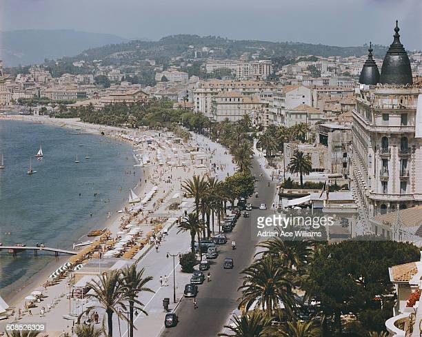 The Boulevard de la Croisette in Cannes on the French Riviera with the InterContinental Carlton Cannes on the right circa 1955