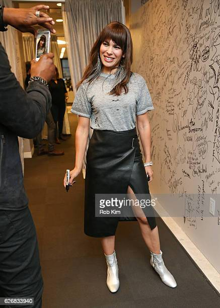 """The Bounce Back"""" cast member Nadine Velazquez signs her autograph at the Build Series at AOL HQ on November 30, 2016 in New York City."""